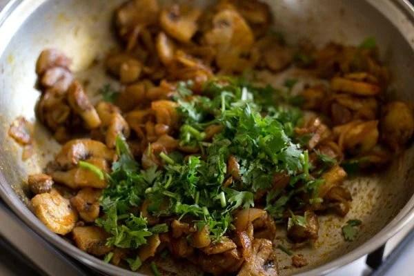 garnishing mushroom stir fry