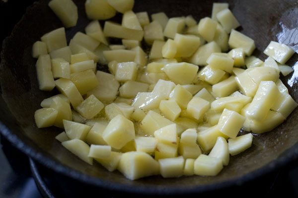 chopped potato cubes in oil