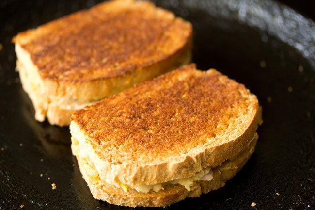 making potato sandwich on tawa
