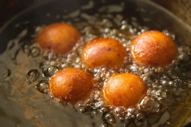 frying jamun - sweet potato gulab jamun recipe