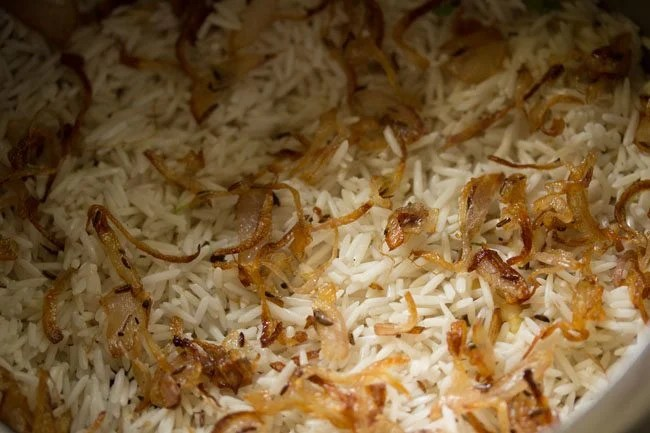 layering biryani - making mushroom biryani in pressure cooker