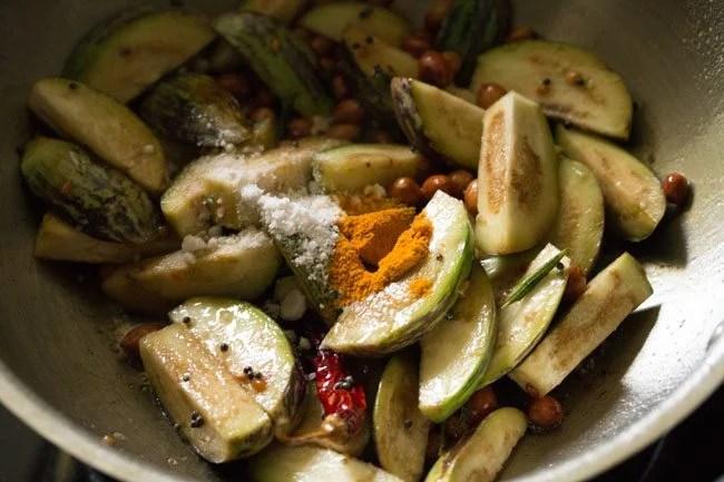 preparing brinjal rice or vangi bath recipe