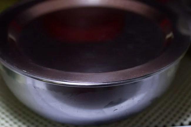 preparing batter for Goan eggless baath cake recipe