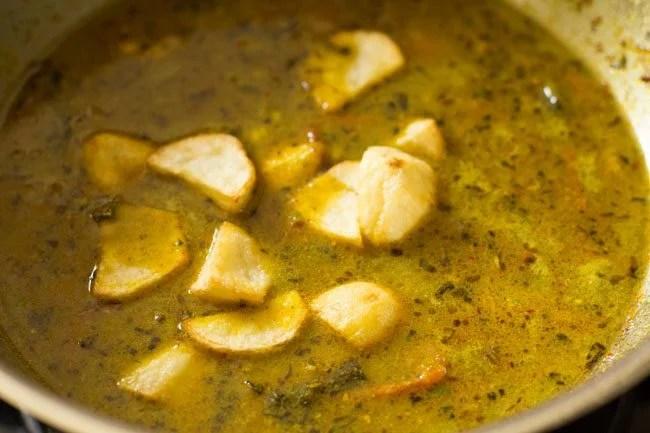 preparing Hyderabadi style dum aloo biryani recipe