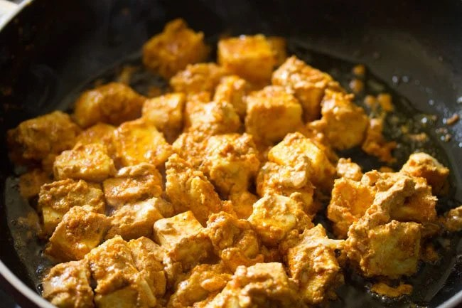 frying paneer cubes for making paneer tikka wrap recipe