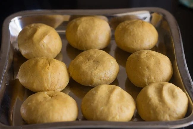 balls made from dough and set aside on a squared steel tray