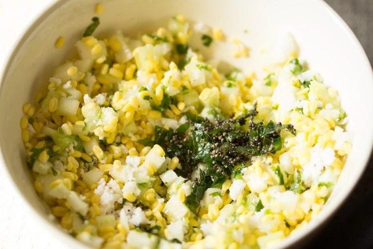 preparing moong dal kosambari recipe