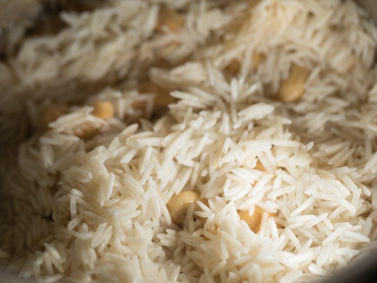 adding rice to pan