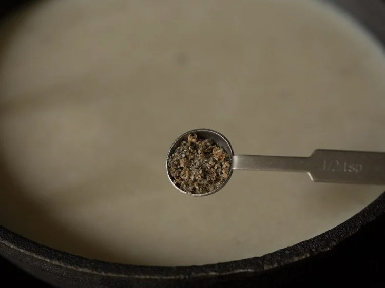 cardamom powder being added
