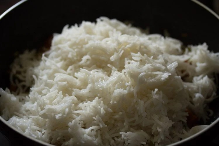 adding rice in parts