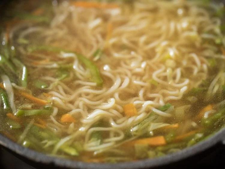 mixing noodle soup