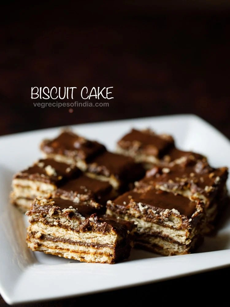 no bake biscuit cake served in a white tray with text layovers