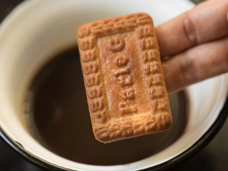 dip biscuit into coffee solution