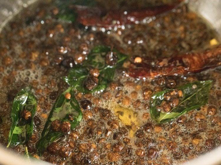 making vathal kuzhambu recipe