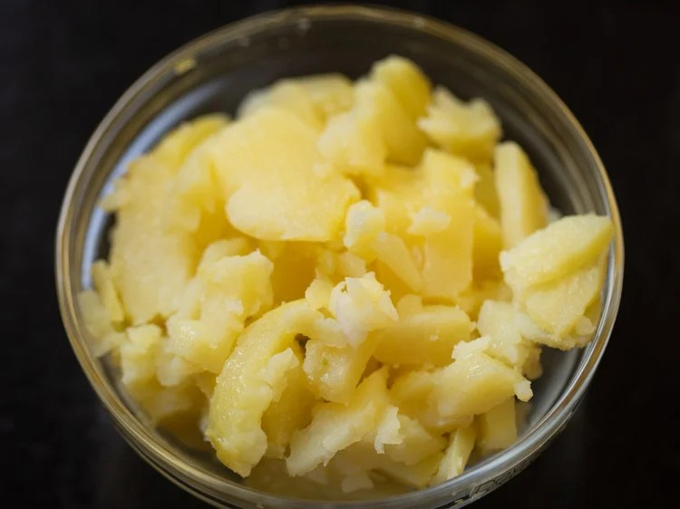 peeling and chopping boiled potato