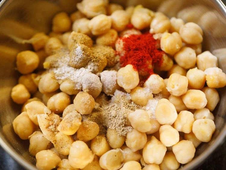 spice powder, salts added to cooked chana
