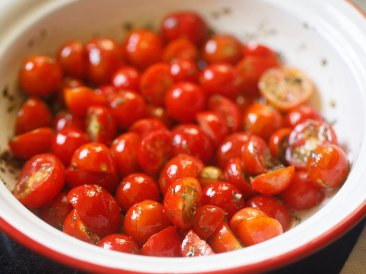 making dressing for cherry tomato salad