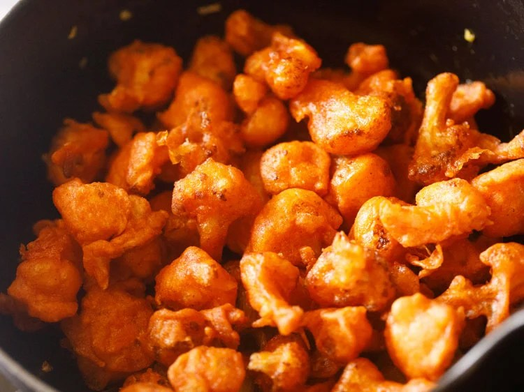 adding the fried cauliflower florets