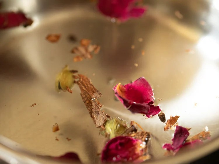 dried rose petals added to water
