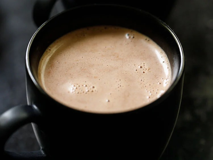 hot chocolate poured in a black cup