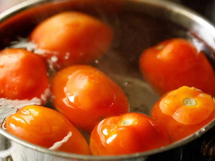 tomatoes immersed in the hot water for 10 to 15 minutes