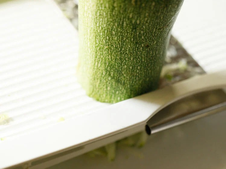 zucchini being grated