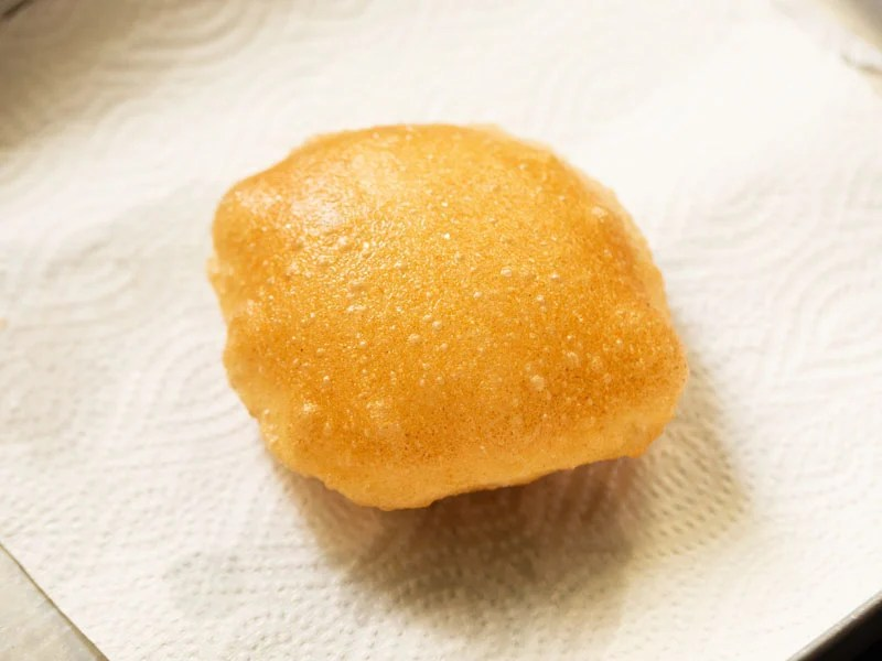 fried poori on a paper towel