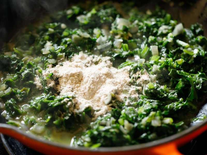 flour added to the spinach mix prior to stirring