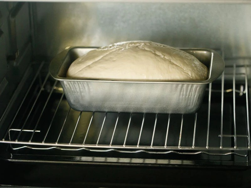 loaf pan with the dough loaf in the oven