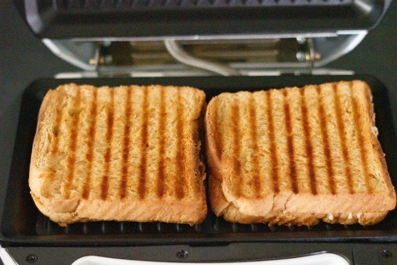 grilled cheese sandwich inside the electric grill