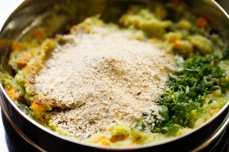 mound of bread crumbs on the spices, seasonings on the mashed veggies