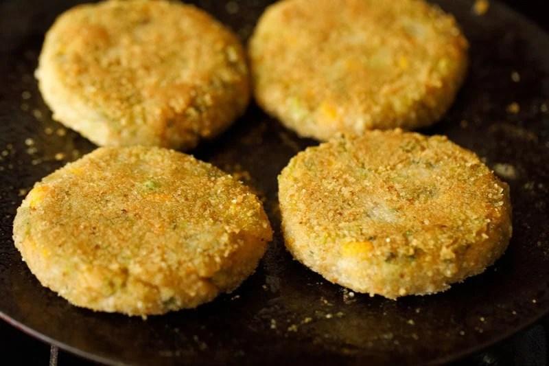 lightly golden pan fried cutlet on skillet