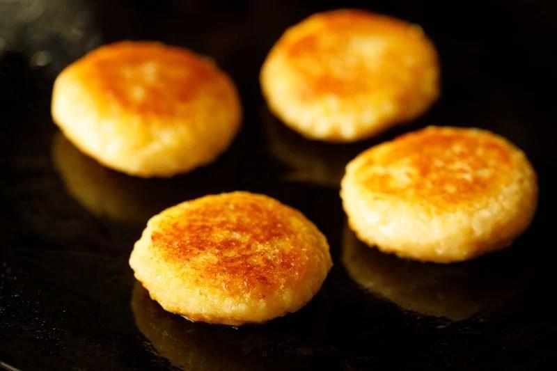 turn the potato patties on the skillet