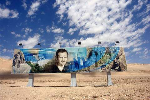 roadside_mural_of_bashar_al_assad_along_the_damascus-aleppo_highway