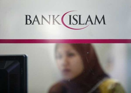 An employee of Bank Islam works at a branch in Putrajaya outside Kuala Lumpur