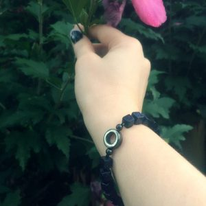 A Power-Bracelet handmade with square Blue Goldstone beads, two small Hematite beads, and a Hematite ring.