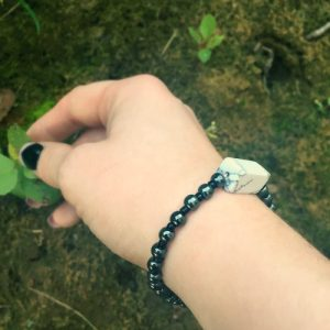 A Power-Bracelet handmade with small, round Hematite beads and one Howlite rectangle bead.