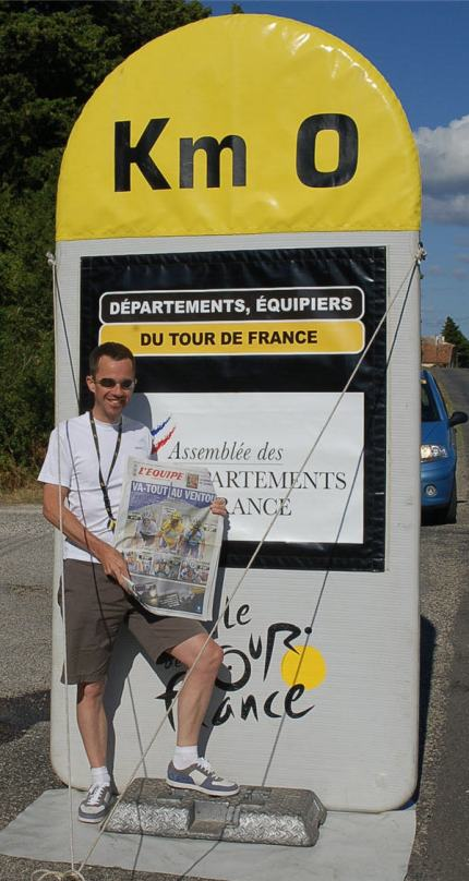 Martin shows today's L'Equipe at the start of the race marker.