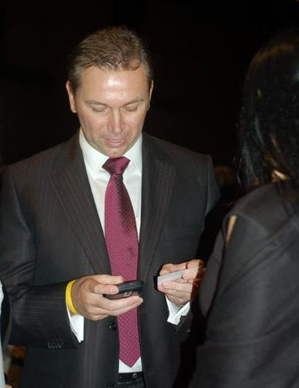 Johan Bruyneel, juggling two phones, one for Astana, the other for Shack business, perhaps?