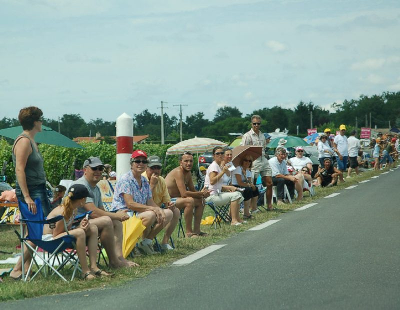 The roadside fans enjoy the show - whatever they're watching.