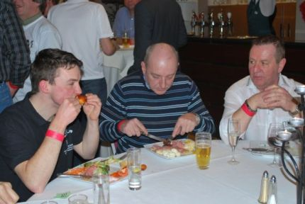 The team bosses keep an eye on Peter's calorific intake at the Team Presentation.
