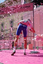 Race Leader Weening beams, waves and there's a 'bang!' as he signs on - shreds of pink paper fly into the air.