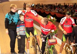 A young fan get gifted a collectors item from the Derny bike rider.