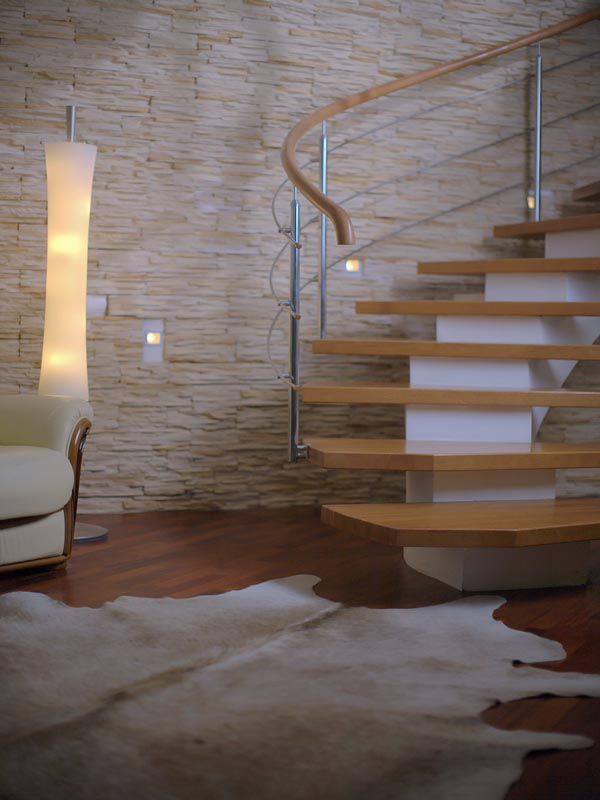 Sandstone cladding as a feature wall behind the staircase