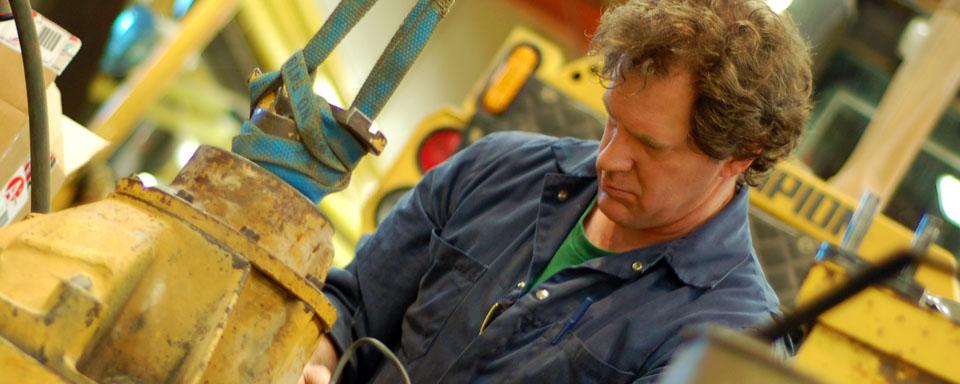 Image showing VEMA qualified repair technician operating repair machinery