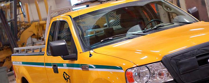 Image of yellow VEMA Manitoba Conversation half-ton truck