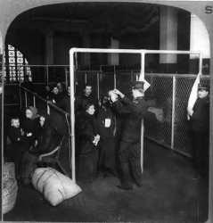 1913-USInspectorsExaminingEyesOfImmigrants-EllisIsland-500