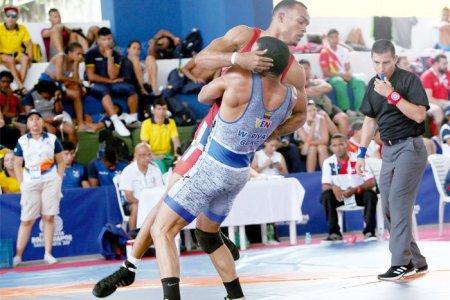 Luchadores y judocas con cosecha dorada en los Bolivarianos