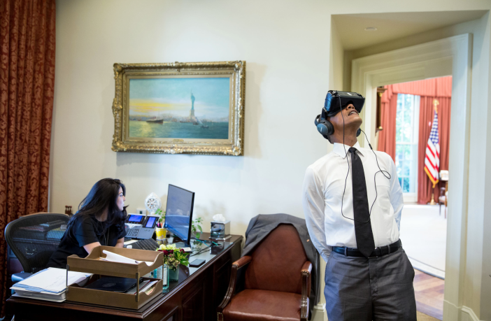 President Barack Obama watches a virtual reality film captured during his trip to Yosemite National Park earlier this year, in the Outer Oval Office, Aug. 24, 2016. Personal aide Ferial Govashiri sits at her desk at left. (Official White House Photo by Pete Souza)