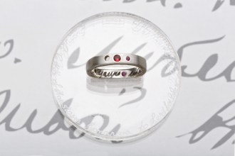 """ring ANASTASIA """"люблю. целую"""" (from the letter of Anastasia Romanova to her father 25 February 1917), 3 rubies, red sapphire, engraving on silver, gilding"""